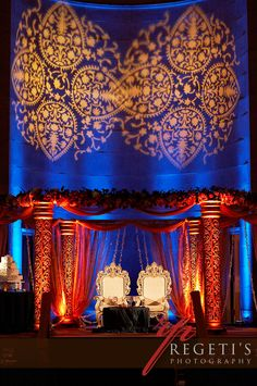 don't love the mandap but like the idea of contrasting it with an image on the wall behind