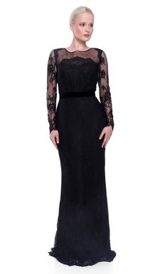 This classic and elegant black gown is crafted from intricate black lace. Wear it for evening with strappy sandals and a clutch.