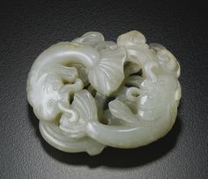 A PALE CELADON JADE RETICULATED 'CATFISH' PLAQUE QING DYNASTY, 18TH / 19TH CENTURY - Sotheby's