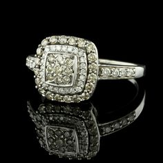 This 14K white gold diamond ring is set with 29 champagne colored diamonds and 32 full cut diamonds