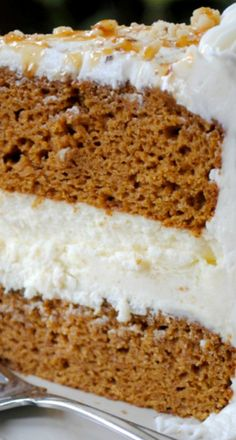 Pumpkin Cheesecake Cake ~ two layers of delicious pumpkin cake with a creamy cheesecake center. Frosted with cream cheese frosting!