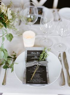Black menu wrapped with striped ribbon at place setting