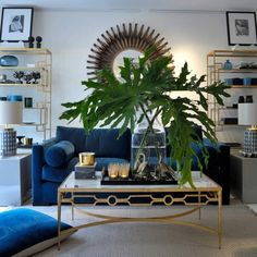 Gorgeous lounge. Love the coffee table setting especially the greenery.