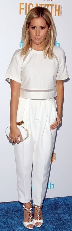 Who made  Ashley Tisdale's white short sleeve top, pants, and gold clutch handbag that she wore in Los Angeles on June 19, 2014