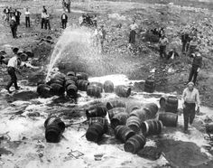 Tears may have mingled with the beer in Newark as Prohibition agents destroy unlawful barrels seized in a Hoboken raid in 1931.