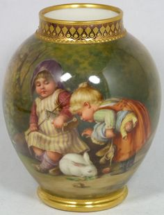 Royal Vienna Porcelain vase of Children Wagner Antique Furstenberg German porcelain portrait vase. Has a stunning hand painted scene depicting two young girls playing together with a rabbit. Made late 19th century to early 20th century. 4 7/8 inches in height.