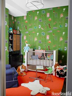 ORANGE + GREEN  Nursery walls are upholstered in Marimekko's playful African Kuningatar in a New York City loft decorated by Steven Sclaroff