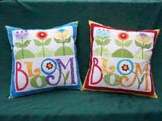 These are the pillows that inspired the cookies I posted a while back. These are two of the four that I just finished....gifts to my sisters and mom for Christmas! Our maiden name is Bloom, so that is why the design attracted my attention. I didn't let the fact that I've never appliqued a thing in my life keep me from giving it a try!