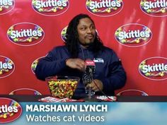 Seahawks player Marshawn Lynch has a big day today. He gets interviewed in a Skittles video and a Progressive video. What happened to his press shyness. Watch the videos to find out. Seahawks Fans, Seahawks Football, Seattle Seahawks, Marshawn Lynch Seahawks, Real Funny Videos, Injury Report, 12th Man