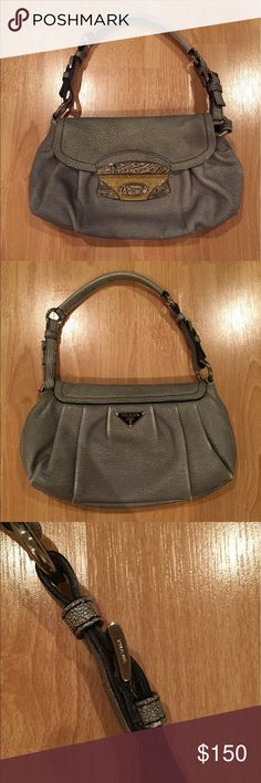Prada leather shoulder handbag vintage Vintage style authentic Prada shoulder handbag in gray leather with an enamel and croc print buckle clasp. Adjustable strap length can be removed to use purse as a clutch. Some wear on corners as shown in pictures but otherwise in good condition. Clean inside. Comes with Prada dustbag. Prada Bags Shoulder Bags
