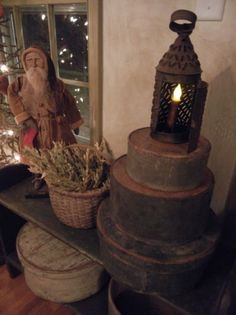 Old Christmas...grungy pantry boxes, tin lantern & Santa.