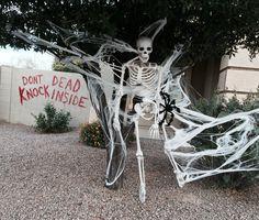 Halloween decor. The walking dead inspiration. Spider eating skeleton.