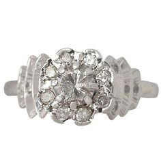 0.92Ct Diamond and Platinum Dress Ring - Vintage and Contemporary | From a unique collection of vintage engagement rings at https://www.1stdibs.com/jewelry/rings/engagement-rings/