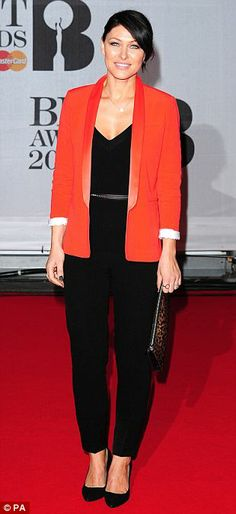Making an effort: TV presenter Emma Willis wore an orange blazer over a black jumpsuit, radio DJ Jo Whiley looked angelic in white, while TV presenter Zoe Hardman shimmered in silver