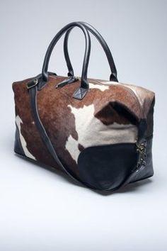 Cow Hide Duffel Bag.