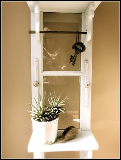 Wooden Garage Door Turned Entry Shelf Turn it in to a key holder Wooden Garage Doors, Old Garage, Window Frame Crafts, Ladder Shelf Diy, Diy Shutters, Old Doors, Funky Junk, Diy On A Budget, Repurposed