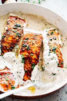 One skillet salmon dinner served with lemon garlic cream sauce. Quick enough for a weeknight dinner & so good you'll feel like you're at a fancy restaurant!