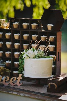 White buttercream cake by Bake the Cake Margaret River. Gorgeous white flowers and greenery from Sorrella Flowe Merchants. Copper cupcakes. Wooden crates. Rustic cake table. Photo by Merge Photography
