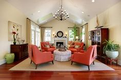 Light, bright, and cheery! love the coral chairs and iron chandelier.    ||||||||| Beautiful living room with coral chairs / by Charmean Neithart Interiors
