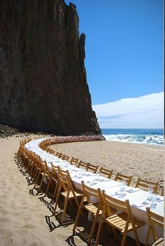 VERY LONG table for the reception or perhaps a family style lunch beautiful view for a wedding reception~
