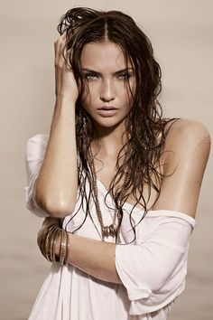Dixie Dixon photo of a female model with wet hair, wearing a white shirt, cropped at the waist