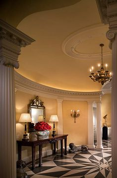 Love this marbled entry way floor, curved walls with pillars, domed ceiling & lighting.