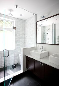 bathrooms - Benjamin Moore - Cloud White - espresso double bathroom cabinet vanity marble countertop espresso framed mirror white porcelain overmount sinks double sinks frameless glass shower marble subway tiles shower surround and double sconces.