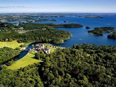 ashford_castle_aerial_view in Ireland. Must go to Ireland too.