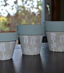 Set of old terracotta flower pots - reloved using 'almond' and 'winter sky' Autentico chalk paint with flower detail stamped in 'brightly white'. Perfect addition to any garden (or window box!).