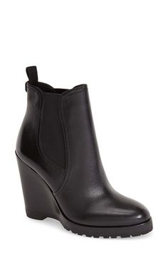 Free shipping and returns on MICHAEL Michael Kors 'Thea' Wedge Bootie (Women) at Nordstrom.com. A lugged platform sole toughens a casual bootie styled with a slim wedge heel and curvy almond toe.