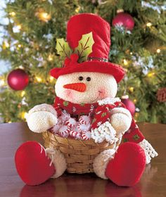 Plush Character Basket looks cute on tables, counters or buffets. He wears a holiday hat with holly and fabric accents and holds an attached bamboo basket that' Snowman Christmas Decorations, Christmas Snowman, White Christmas, Christmas Stockings, Christmas Ornaments, Felt Crafts, Diy And Crafts, Christmas Crafts, Holiday Hats