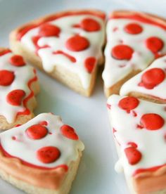 These are sugar cookies that look like pizza! They're super easy to decorate, and the kids will have a hoot when they see them. Bake them for when you get together to watch a movie about some pizza-loving ninja turtles!