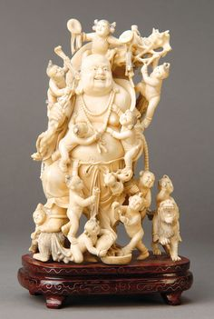 Large sculpture of a potbelly buddha, China, in 1900, children scenes, fine carving with 12fully three-dimensional figures and children with 2 Fo-dogs, H.ca. 21.5 cm, on wooden base,H. 26 cm