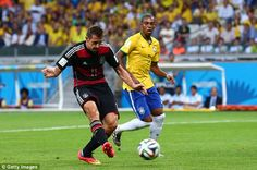 Lethal finisher! Klose guides the ball into the net as Brazil midfielder Fernandinho watches on