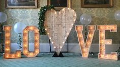 rustic heart backdrop with rustic light up love letters