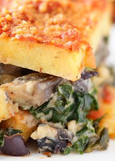 """A DELICIOUS polenta lasagna recipe that is fabulous with spinach. In fact, the spinach and mushroom """"filling"""" is so delicious it can stand on its own as a version of creamed spinach!"""