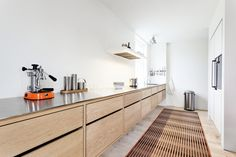 As a bespoke kitchen manufacturer, we are able to do things a little differently, that is if you are looking for something other than the contemporary German handleless style. The following examples of handleless kitchens show the diverse range of styles