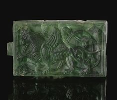 A Rare Fatimid Moulded green glass plaque, North Africa, 10th century | lot | Sotheby's
