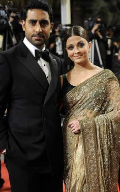 Love the pattern of the sari! Would be a gorgeous strapless dress! And Aishwarya Rai looks gorgeous with her hubby!