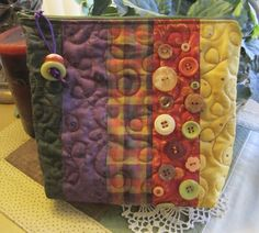Zippered Bag with Buttons by Denise Clason--- My sister's pattern.  I plan to make this, one day! jm