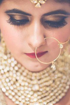 Indian Bridal Makeup - Bronze Bridal Eye Makeup with Plum Colored Lips and Extended Eyelashes | WedMeGood #wedmegood #makeup