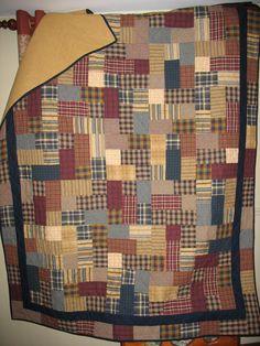 Quilt made from homespun plaids using the hopscotch pattern.