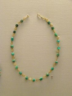 Roman emerald and gold necklace in British museum - Necklace of emeralds set between gold rods.2-3rd c. AD