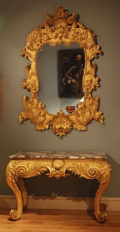 "A George II Giltwood Mirror En Suite With Carved Gilded Marble Top Side Table. Ca1735 England. Mirror = 67""H x 44""W, Table = 31""H x 48""W x 23""D."