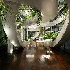 Take this exact same space, and do one thing to it...subtract the plants.  How bland is that?  They liven up the space, make it feel fresh, and soften the sweeping lines in the space.  Beautiful.  Panoramic Garden - SADAR + VUGA