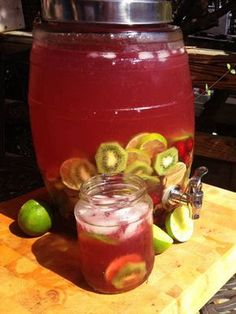 12 limes, sliced 12 kiwi, sliced 2 lbs. cherries 16 oz. POM Cherry Juice 12 oz. agave nectar 20 oz. lime juice 22 oz. vodka  Muddle cherries in a punch bowl or pitcher. Add ice and remaining ingredients. Stir gently.  Source: Chef Anthony Pino, Anthony David's