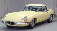 Yellow 1968 Jaguar XKE Roadster  My Dad's was Wedgewood blue...navy blue leather interior.