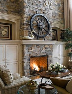 Inspiration for my living room remodel, cabinets and rock fireplace.