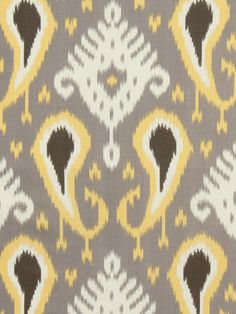 A modern cotton ikat upholstery and drapery fabric in butter yellow, nickel, walnut and white. See applications and additional color links below.