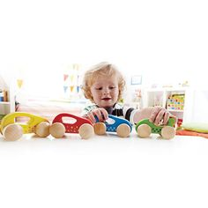 First Wooden Cars - set of 4 - A set of little wooden cars for children to push and move around using the handles built in. Kids will have loads of fun with this product, racing the cars against each other or just driving them round together.   This is fantastic for small hands as there is a handle on each car, so it will help them with their fine motor skills as well as their coordination and co-operation as they play in harmony.